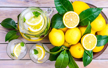 Water with lemon and mint in glasses and jug.Healthy drink,detox