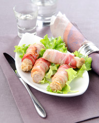 white Bavarian sausages wrapped in bacon