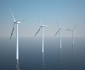 Wind turbines in motion on the ocean with blue sky.