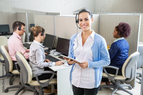 Happy Customer Service Representative Holding Tablet Computer - 80450909