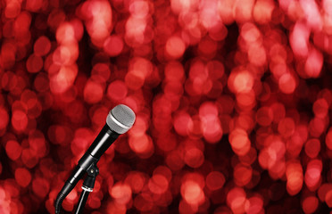 Microphone on bright red background