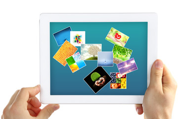 Hands holding tablet PC with different pictures