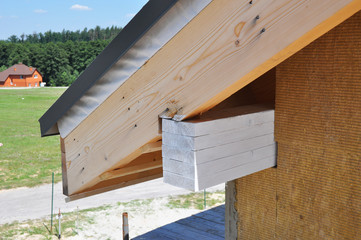 Corner of house under construction with eaves, soffits.