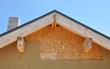 Attic new house facade insulation against blue sky - 80454735