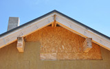 Attic new house facade insulation against blue sky - 80454735