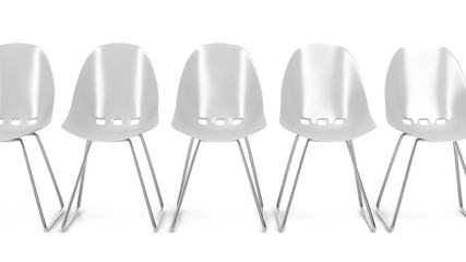 White plastic chairs and one unique red chair