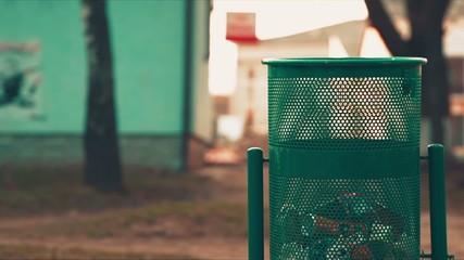 Man Throws Trash in Dustbin