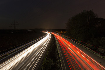 highway with light trails at night