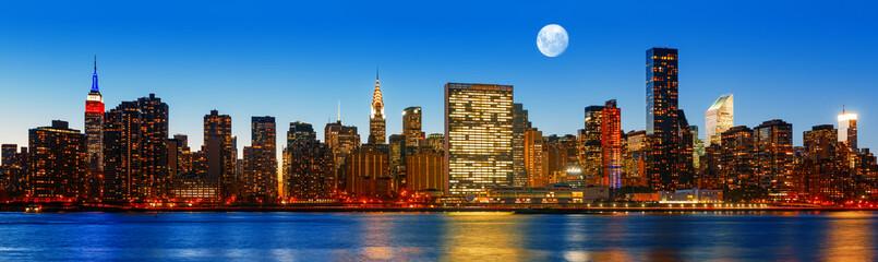 Late evening New York City skyline panorama
