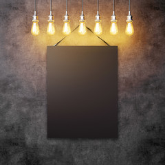 Blck canvas hanging under decorative vintage lightbulbs