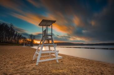 Lifeguard hut on lake shore. Long exposure photo