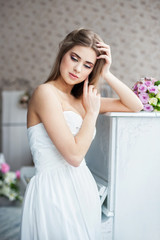 Beautiful woman posing in a wedding dress