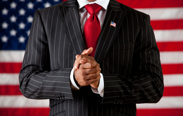 Politician: Man with Hands Clasped