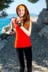 Sport woman running near the sea