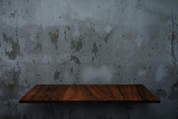 Empty wooden shelf on concrete wall texture