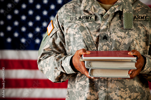 Soldier: Student Holding Stack of School Books - 80460543