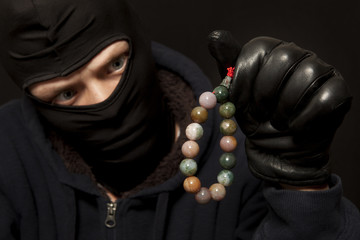 Thief with a necklace