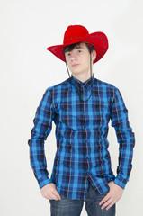 Teenager wearing cowboy cap