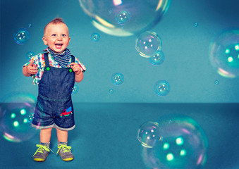 funny little boy with bubbles