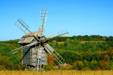 Old wooden windmills at autumn season