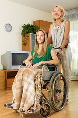 Woman helping handicapped girl