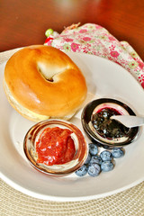 Bagel with jelly and blueberries