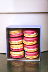 Box with macaroons on the shop display
