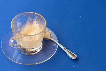 Coffee glass is then used on a blue background.
