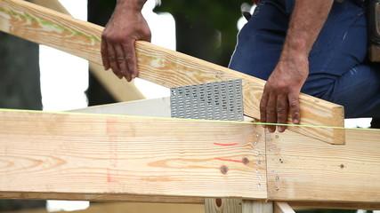 Carpenter Nailing Roof Truss