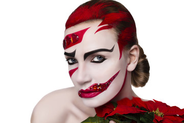 Studio portrait of a woman. Art make-up in red.