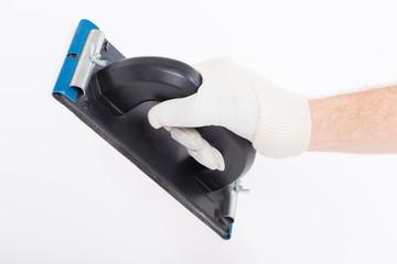 Hand using plastering trowel
