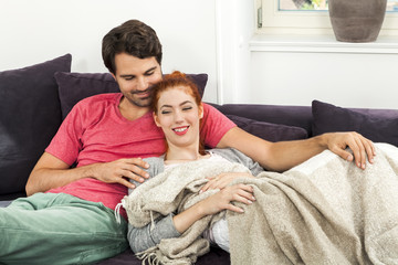 Couple Resting on the Sofa at the Living Room