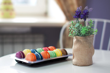 Assorted macarons on a table in cafe