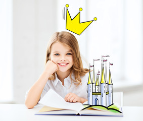 smiling girl reading fairytales at home