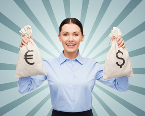 businesswoman holding bags with dollar and euro