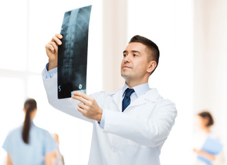 male doctor looking at x-ray in hospital