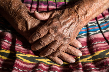 hands of a very old mayan midwife