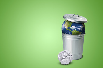 Planet earth in a trash can and crumpled paper