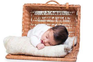 Cute baby girl in a basket