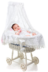 Cute baby girl in a carriage