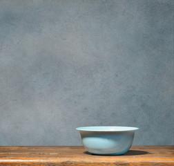 Blue bowl on blue grunge background
