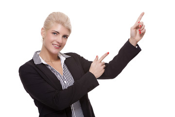 Businesswoman Pointing Up While Looking at Camera