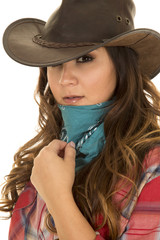 cowgirl close hand on bandana by face