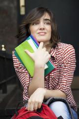 Gorgeus short hair woman with books