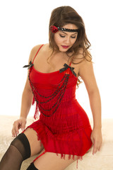flapper girl in red sit look down
