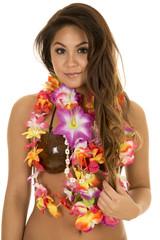 Hawaiian woman coconut bra close slight smile