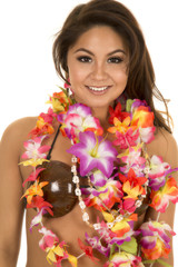 Hawaiian woman coconut bra close smile