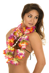 Hawaiian woman with lei around neck side looking back