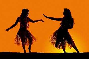 silhouette of Hawaiian woman grass skirts dancing