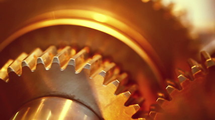 Golden gears with cogs in action. HD 1080p